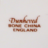 Dunheved China. Hand Painted in Cornwall by Derek Wilson.&nbsp;<br /><br />Derek was trained at Royal Worcester in the skill of 'Painted Fruit' on Bone China. He and his partner Sheila Whitcombe (a Royal Worcester modeller) moved to Cornwall several years ago and set up their business Dunheved China. They specialised in decorating blank china items with fruit designs, birds and animals and some local scenes on plates of various Cornish places.