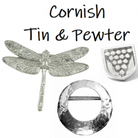 <p>Silk scarves with pewter scarf rings and brooches. All gift boxed.<br /><br />Scarf rings and brooches are made in Cornwall using Cornish pewter.</p>