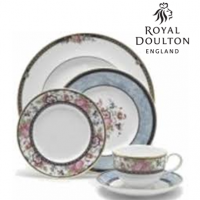 A perfect collection for the dreamer and the rose devotee, Centennial Rose tableware from Royal Doulton is classically lovely. Crafted from bone china, the pattern features central clusters of roses and forget-me-nots and delicate floral wreaths. Sponged soft blue borders and bands of 22-karat gold complete the design. With beautiful variation throughout the collection, Centennial Rose is an excellent choice for the entertainer with a romantic sensibility.<br /><br />Royal Doulton Centennial Rose was produced from 1997 to 2008.