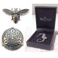 <p>Ladycrow - Made in Scotland - Silk scarves with pewter scarf rings and brooches. All gift boxed.</p>