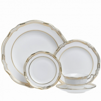 "<p class=""bodytext"">Dazzling opulence describes a formal table set with Spode's Sheffield pattern. Crafted in ornate Old-World style reminiscent of a queen's dining décor or castle banquet hall, the collection features translucent fine bone china with gleaming white centers bordered by lavishly applied 22-carat-gold accent work. Wide trim, raised leaf sprigs, and shimmering flower motifs make a grand initial impact, while scalloped rims, wavy contours, and realistic leaf and acorn knobs offer a refined, feminine finish.</p>